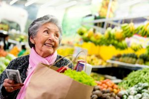 Senior woman shopping for groceries