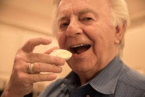 senior man eating a hard-boiled egg