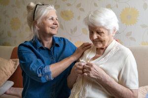 middle stages of Alzheimer's senior daughter caring for senior