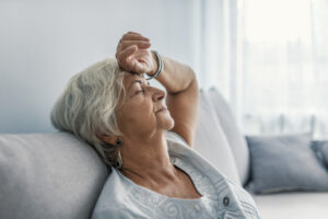 Elderly woman experiences chronic senior fatigue