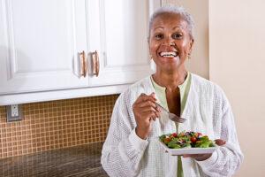 senior-woman-eating-salad_800px