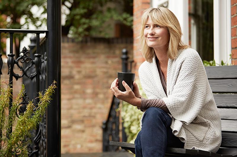 lady-sitting-outside-smiling